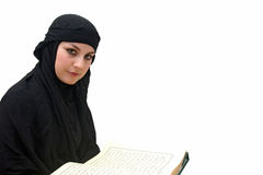 Islamic woman with Koran Royalty Free Stock Photo
