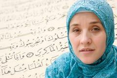 Islamic woman and Koran stock photos