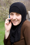 Islamic woman with mobile phone Royalty Free Stock Photos