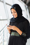Islamic woman phone. Happy islamic woman using smart phone Stock Image