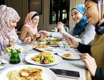 Islamic women friends dining together with happiness stock photos