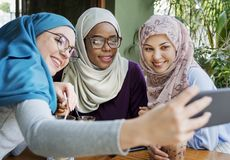 Islamic women friends taking selfie together royalty free stock image