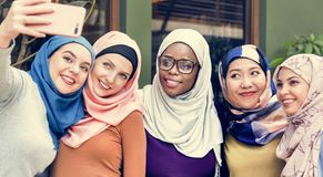 Islamic women friends taking selfie together royalty free stock photos