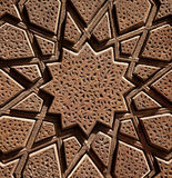 Islamic Wooden Star Shaped Design Carved on Brown Wood Royalty Free Stock Images