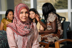 Islamic Young Woman. With diverse group of female students dressed in traditional clothing inside school setting stock photos