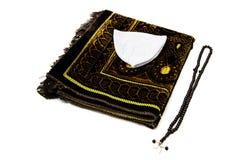 Islamisk bönhatt och ämbetsdräkt, bönfilt som används i bön, bön för att göra skallen, islamiska diagram och symboler, islamiska  Arkivfoton