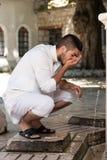 Islamisk ceremoni för religiös ritual av tvagningmuntvagningen Royaltyfri Fotografi