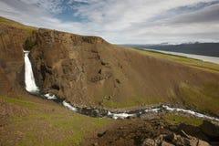 Island. Östliga fiords. Lagarfljot område. Litlanesfoss vattenfall Arkivfoton