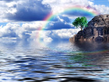Island. Tree on the sea with rainbow  in the sky Royalty Free Stock Photos