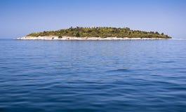 Island. Scenic island in deep blue water Stock Photography