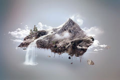 Island. Rocky island with waterfall flying over clouds Royalty Free Stock Image