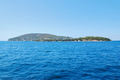 Island. View of tropical water surface and lonely island in the distance. Kaşık island(spoon island Royalty Free Stock Photography