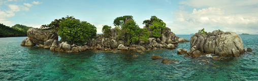 Island. A small island in the ocean Stock Photos