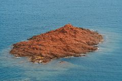 Island. Red rock Island in Mediterranean sea in french riviera Stock Photos