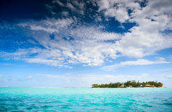 Island. Small tropical island, turquoise ocean, blue sky Royalty Free Stock Photography