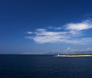 Island in Adriatic sea with beacon Royalty Free Stock Photography