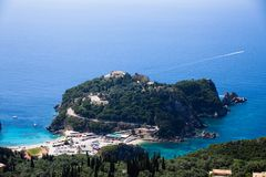 Island aerial view blue ocean behind. Beautiful Greek landscape. Corfu Greece natural places and beaches. Mountain next to sea wat. Er. Gorgeous place. Traveling royalty free stock images
