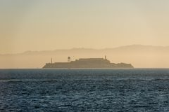 Island and Alcatraz prison at sunrise from Fort Point, San Francisco royalty free stock photos