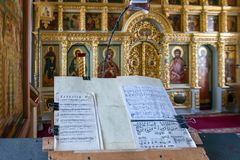 Music stand with notes in front of the altar of the Church of the Crucifixion of Christ. ISLAND ANZERSKY, RUSSIA - JUNE 26, 2018: Music stand with notes in front stock photos