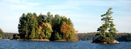 Island in Autumn. In a lake in Ontario Royalty Free Stock Photos