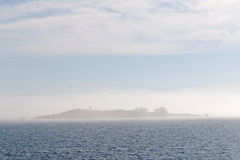 Island barly visible in the mist Royalty Free Stock Photo