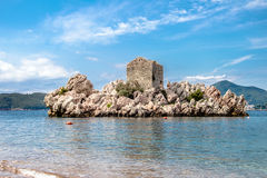 Island in the Bay of Milocher.Montenegro. The island in the bay with the ancient building Milocher .Montenegro Stock Image