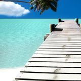 Island beach. A beach with a bridge and coconut Stock Images