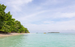 Island with beach and boats Royalty Free Stock Photo