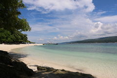 Island beach. Calm and clear beach resort perfect for any projects Royalty Free Stock Photo