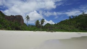 Island beach in indian ocean on seychelles. Travel, seascape and nature concept - island beach in indian ocean on seychelles stock video footage