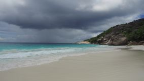 Island beach in indian ocean on seychelles. Travel, seascape and nature concept - island beach in indian ocean on seychelles stock video