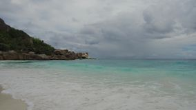 Island beach in indian ocean on seychelles. Travel, seascape and nature concept - island beach in indian ocean on seychelles stock footage