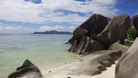 Island beach in indian ocean on seychelles. Travel, seascape and nature concept - rocks on island beach in indian ocean on seychelles stock footage
