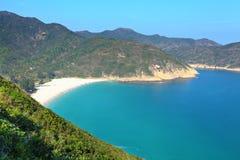 Island with beach and mountain Stock Photos