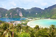 Island beach, palm trees, mountains and bay with boats top view, Phi Phi Island, Thailand royalty free stock image
