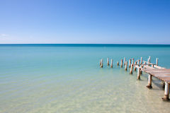 Island Beach Pier View. Pier at Combate Beach in Cabo Rojo, Puerto Rico Royalty Free Stock Images