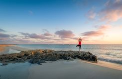 Island beach sunrise and yoga practice Royalty Free Stock Photos