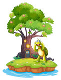 An island with a big tree and a turtle Stock Images