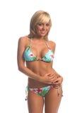 Island Bikini Blonde. Sexy blond swimwear model in a blue tie side island print bikini with hibiscus flowers and palm trees Royalty Free Stock Photos