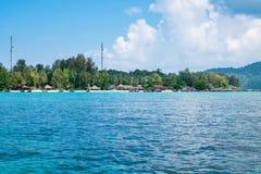 Island blue indigo sea with resort on beach stock images