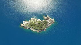 Island in blue sea stock footage