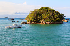 Island boat sea mountains Abraao Beach of Ilha Grande, Brazil Royalty Free Stock Photo