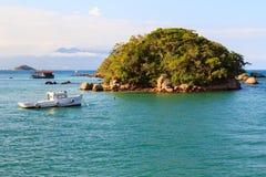 Island boat sea mountains Abraao Beach of Ilha Grande, Brazil Royalty Free Stock Photo