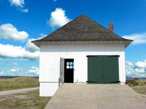 Island Boathouse. An island boathouse against a summer sky on South Manitou Island, MI stock image