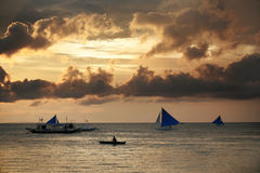 Island Boracay. Traditional Philippine boats on sunset. Island Boracay Royalty Free Stock Photos