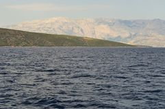Island Brac and mountain Biokovo in background. Croatia Royalty Free Stock Images