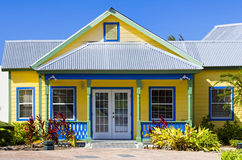 Island Bungalow. Cute yellow and blue frame house used as a park headquarters on Grand Cayman Island Royalty Free Stock Photo
