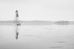 Island and buoy in a lake Royalty Free Stock Images