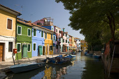 The island of Burano. Burano is best known for its small, brightly-painted houses Stock Image