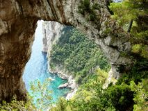 Capri. A summer day on Capri island with a beautiful view of sea between the rocks Royalty Free Stock Photo